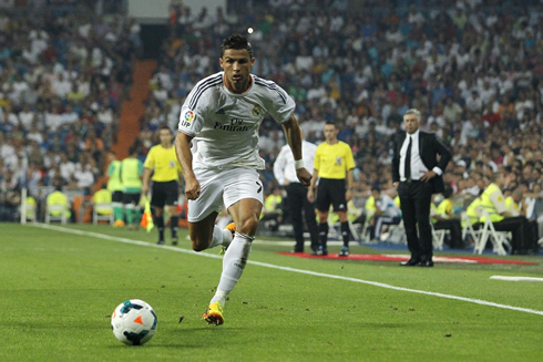 Cristiano Ronaldo sprinting with Carlo Ancelotti behind