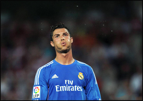 Cristiano Ronaldo whistling while wearing Real Madrid's new blue kit for 2013-2014