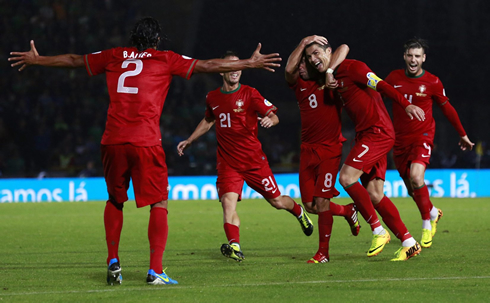 Cristiano Ronaldo celebrating a goal with his Portuguese teammates