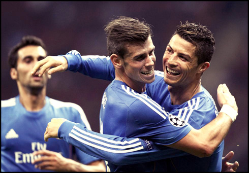 Cristiano Ronaldo celebrates his hat-trick with a hug to Gareth Bale