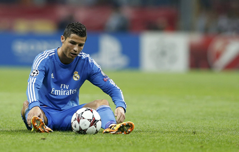 Cristiano Ronaldo sits down and stares at the ball
