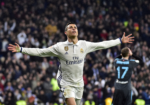 cristiano ronaldo opens his arms to real madrid fans at the bernabeu in 2017