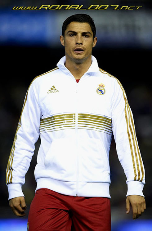 Cristiano Ronaldo in the new Real Madrid training kit (white jacket with golden stripes), for 2011-2012